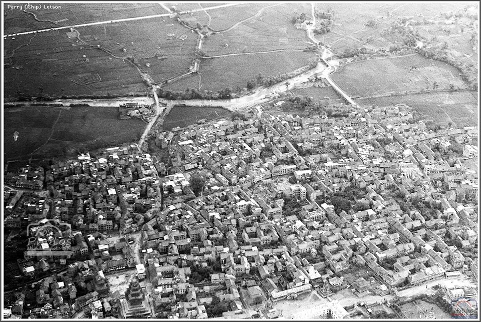 From the air, one can see the Hanumante River, two bridges the Bhaktapur durbar square complex, and Nyatapola temple of the ancient town in 1971 image