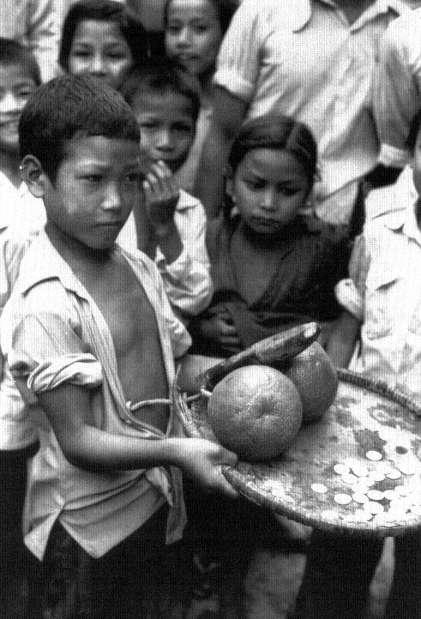 Gatha Mu:ga chare Children holding a phallic representation of Gatha Muga block the streets and demand money for passage image