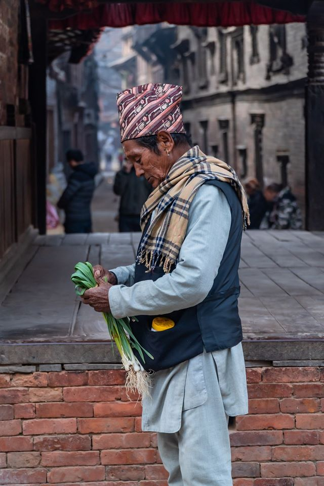 People are seen strolling around the city in search of freshly cultivated veggies brought directly from the farms of the local farmers image