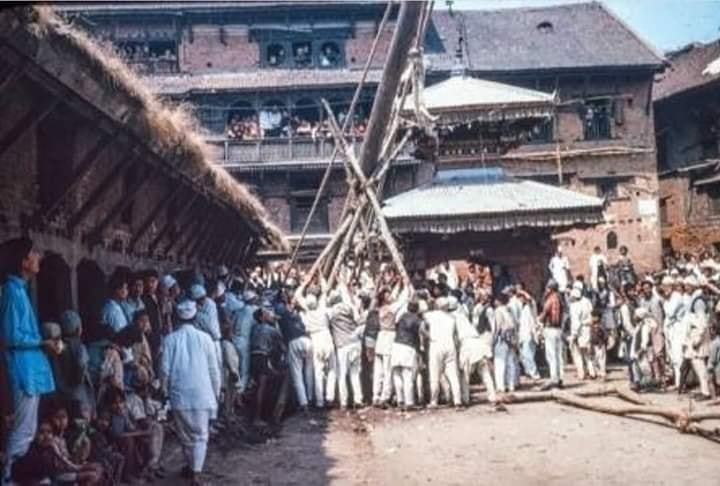People standing the long wooden pole ( lingo ) remark as a begining of a Biska Jatra image