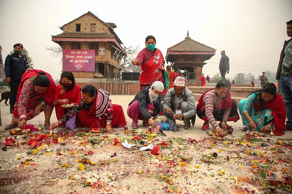 People worshipping in the name of Lord bhairab in an empty space during lockdown image