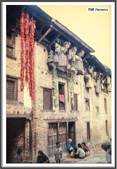 Ropes of chilies and garlic drying while hanging from roof braces and windows of homes in Bhaktapur, 1969 image