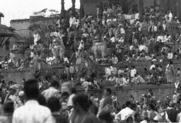 Spectators seated on the steps of the Nyatapola temple in Taumadhi Square to watch the struggle to pull the Bhairava Chairot image