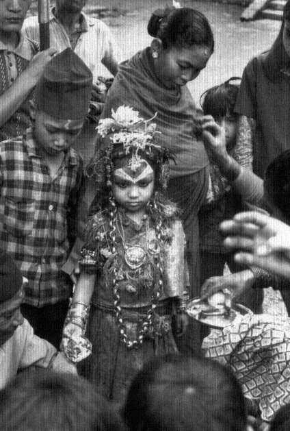 The living goddess Kumari, People are making offerings and receiving prasad image