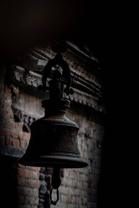 Bell stands as an epitome of the historic and pious city of Bhaktapur image
