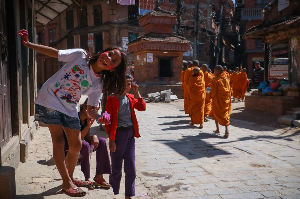Monks daily visit to the city of bhaktapur during holi image