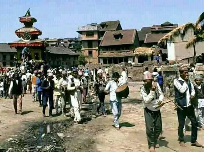 People playing instruments going back after worshiping Lorb Bhairab image