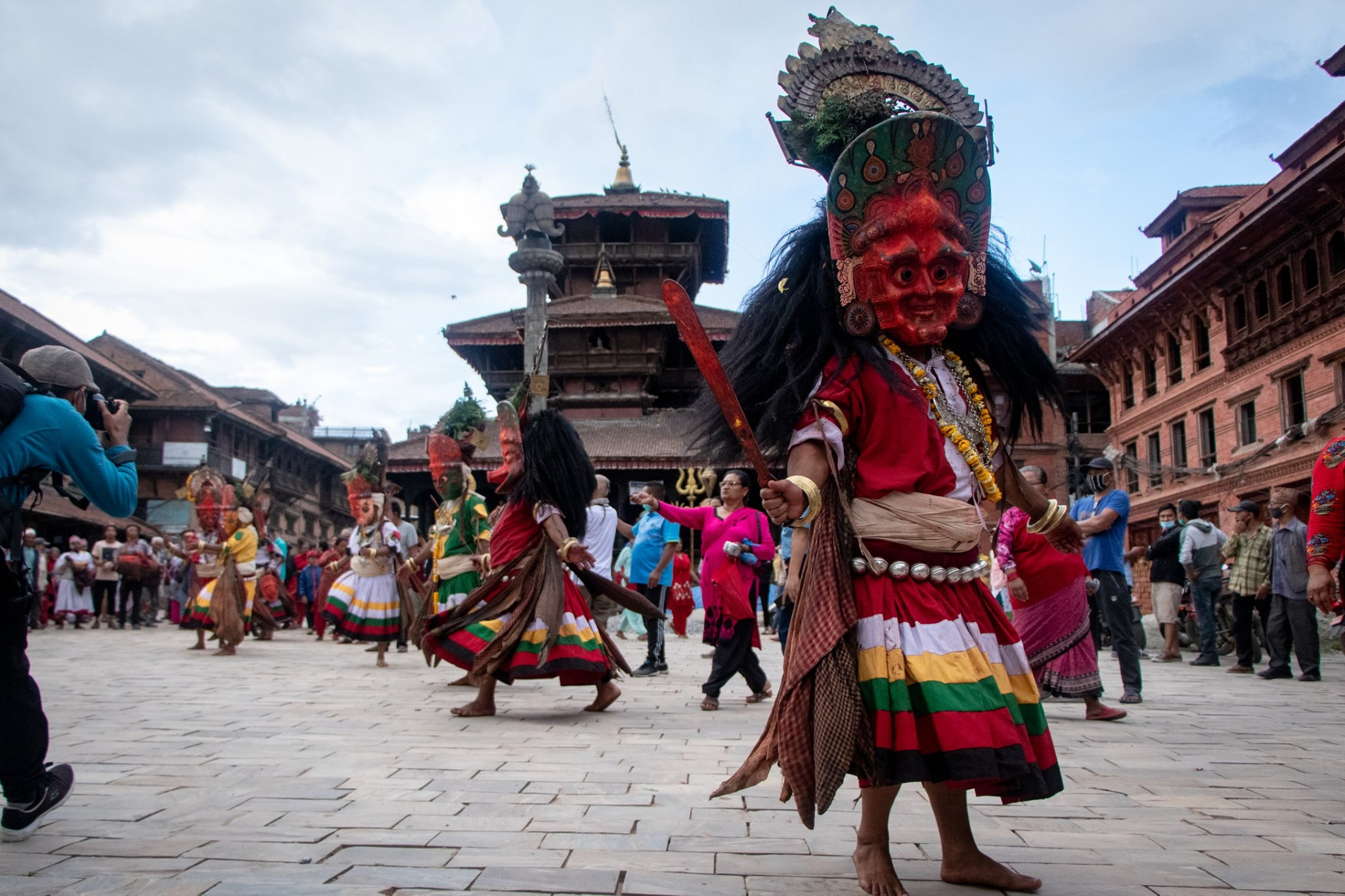 Along in the way to the craziest masked plus street dance of Nepal image