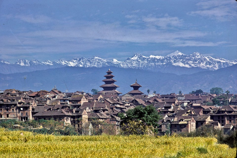 The ancient city with Nyatapola Temple located with the Himalayas including Langtang Lirung in the background. image