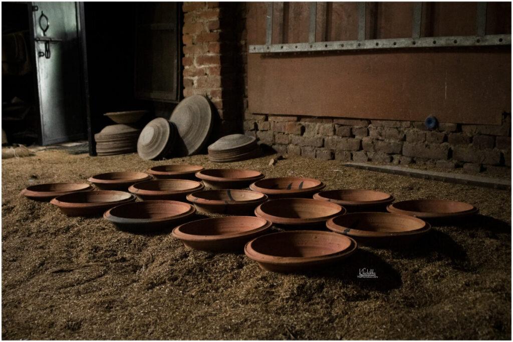 empty clay pots-process of making juju dhau